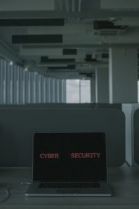laptop with cyber security text on the screen